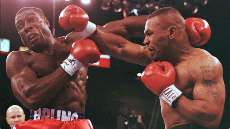 Frank Bruno (left) one of many iconic Brits to fight for a heavyweight title