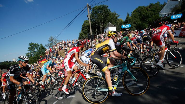 The peloton makes the climb of the Mur de Huy to the finish of stage three of the 2015 Tour de France