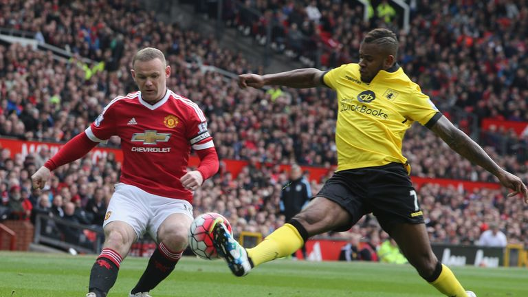 Rooney tries to get the better of Aston Villa's Leandro Bacuna