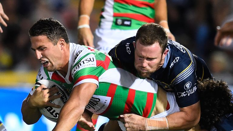 Sam Burgess of the Rabbitohs is tackled by Gavin Cooper  and Jake Granville of the Cowboys