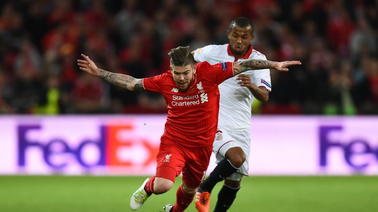 Alberto Moreno is challenged by Mariano in the first half