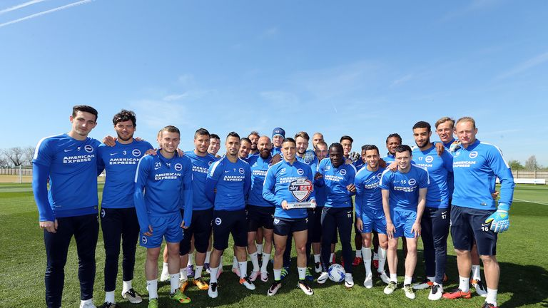 Anthony Knockaert celebrates his Player of the Month award with his Brighton team-mates