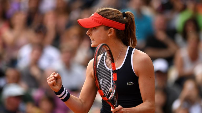 Alize Cornet came through a bout of cramp to beat Maria