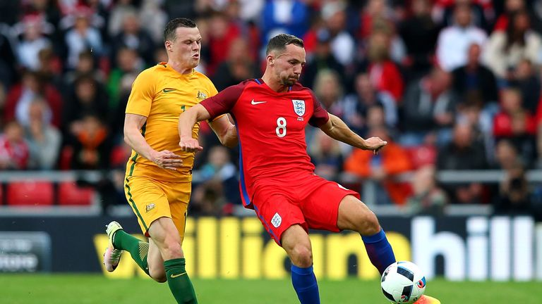 Smith (L) in action for Australia against England