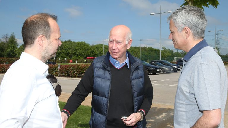 Jose Mourinho greeted by Sir Bobby Charlton (middle) at United's AON Training Complex