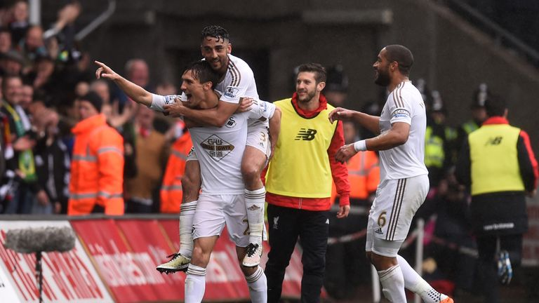 Cork  celebrates his brilliant goal at the Liberty Stadium