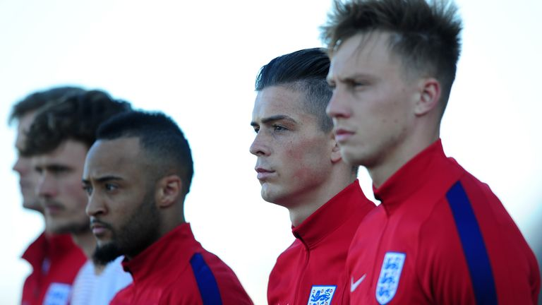 Jack Grealish (second right) lines up for England's U21s before making his debut against Portugal as a second-half substitute