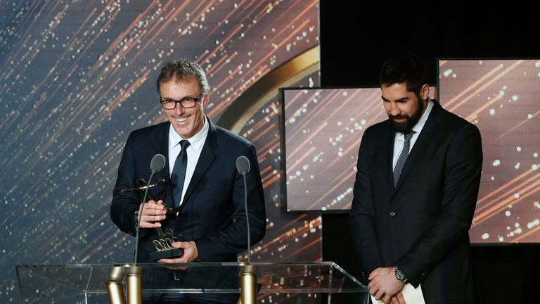 Paris Saint-Germain's French coach Laurent Blanc (left) receives the Ligue 1 2015-2016 Manager of the Year award