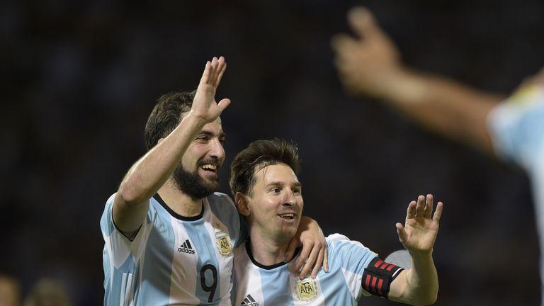 Argentina's Gonzalo Higuain (L) and Lionel Messi celebrate