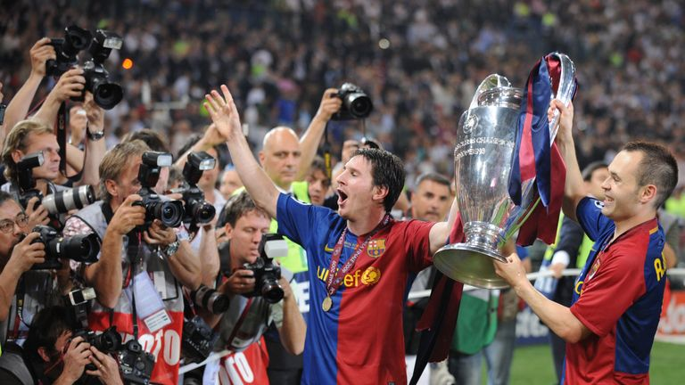 Lionel Messi and Andres Iniesta celebrate with the Champions League trophy