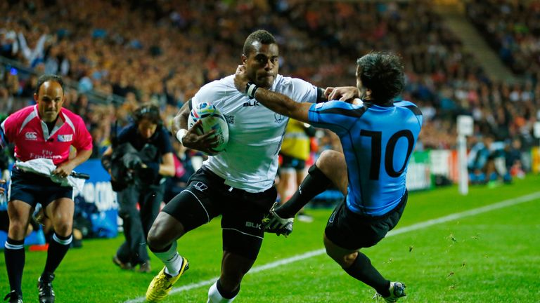 Nemia Kenatale holds off Alejo Duran of Uruguay as he scores a try for Fiji during the 2015 Rugby World Cup