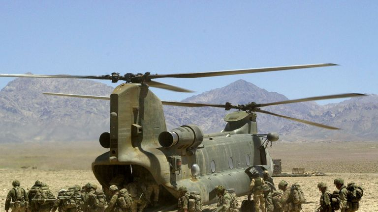 Royal Marines board a Chinook helicopter in Afghanistan
