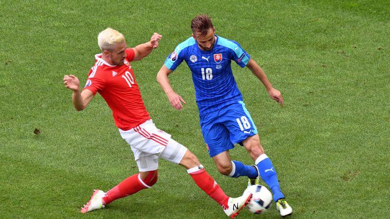 Wales' midfielder Aaron Ramsey vies for the ball against Slovakia's midfielder Miroslav Stoch