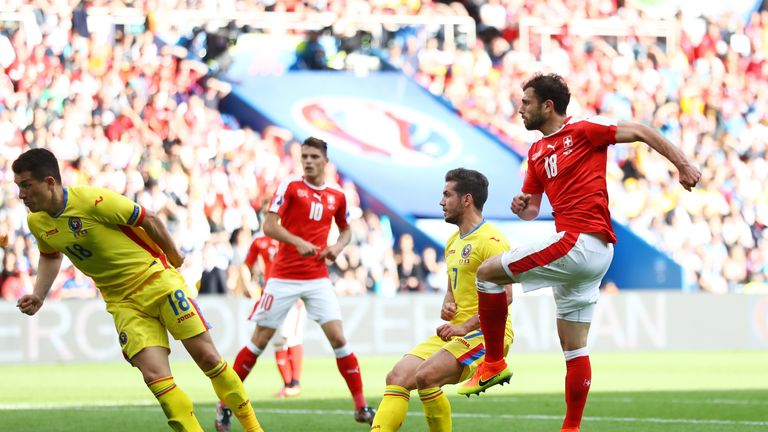 Admir Mehmedi of Switzerland scores his side's goal against Romania