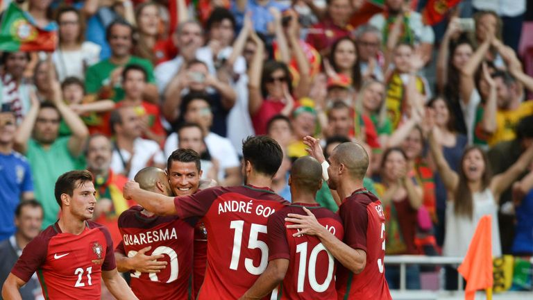 Two first-half goals from Cristiano Ronaldo (third from left) helped Portugal to a 7-0 demolition of Estonia on Wednesday