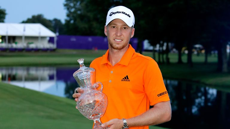 Berger celebrates with the trophy after claiming victory at TPC Southwind