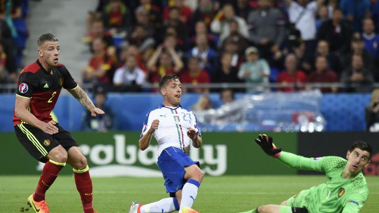 Italy's midfielder Emanuele Giaccherini (centre) scores against Belgium