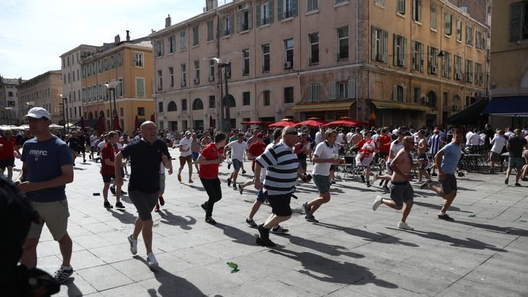 England fans flee from violence reportedly instigated by Russian hooligans