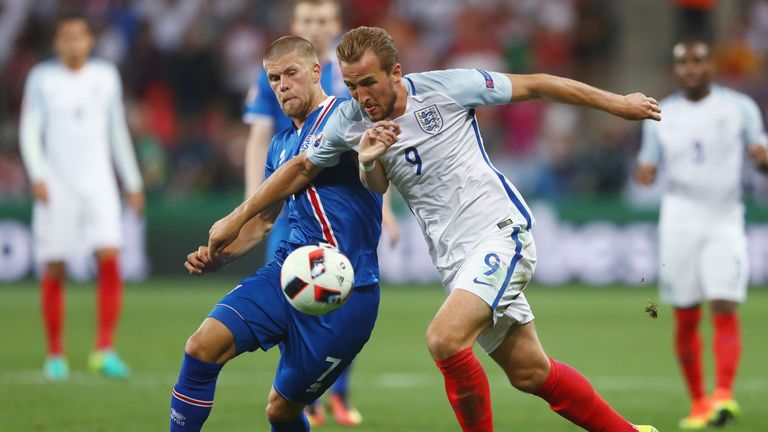 Harry Kane (right) competes with Johann Gudmundsson