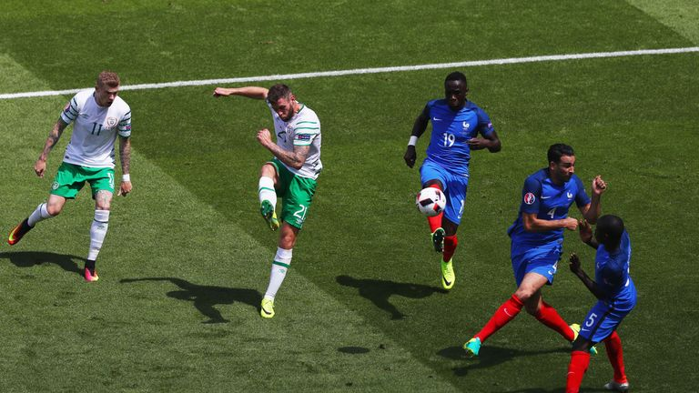 Daryl Murphy takes a shot at goal during the match in Lyon