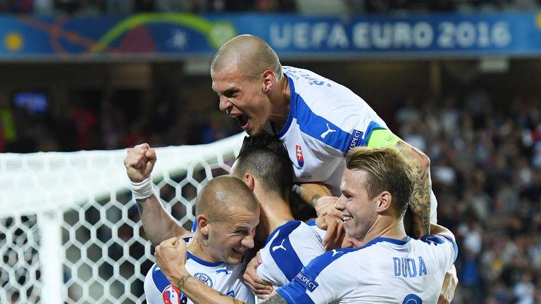 Marek Hamsik of Slovakia is mobbed by teammates