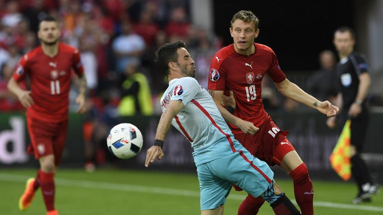 Turkey's defender Gokhan Gonul (left) vies with Czech Republic's midfielder Ladislav Krejci (right)
