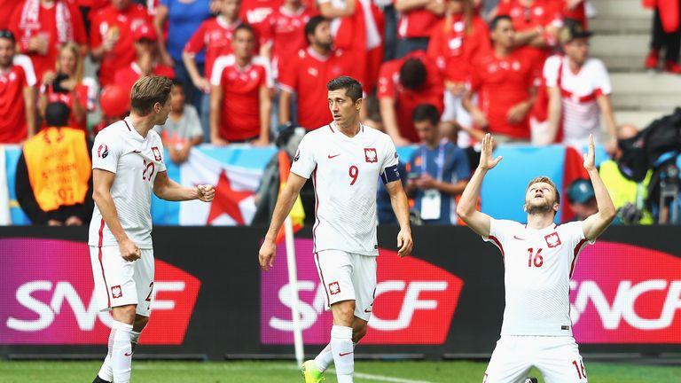Jakub Blaszczykowski drops to his knees after putting Poland ahead