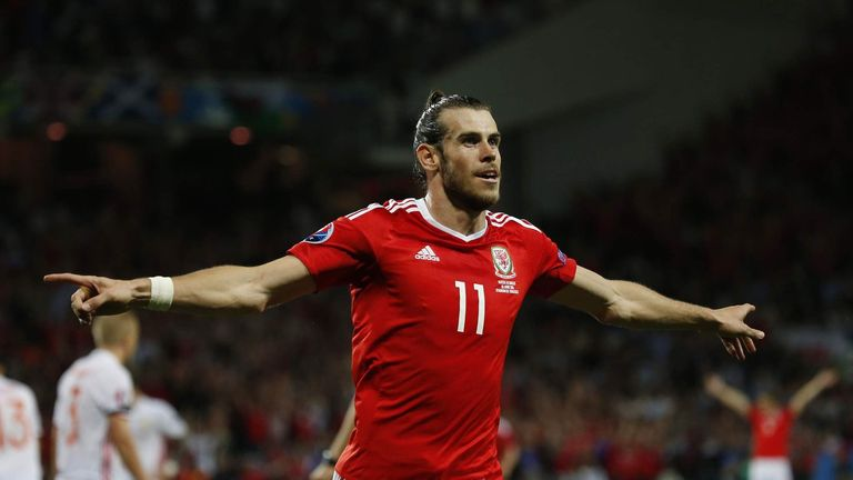 Bale shows his delight after making it 3-0 to Wales in the second half