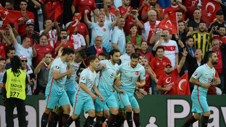 Burak Yilmaz celebrates his early goal for Turkey in Lens