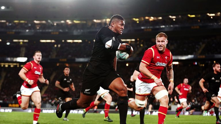 Waisake Naholo of New Zealand makes a break against Ross Moriarty