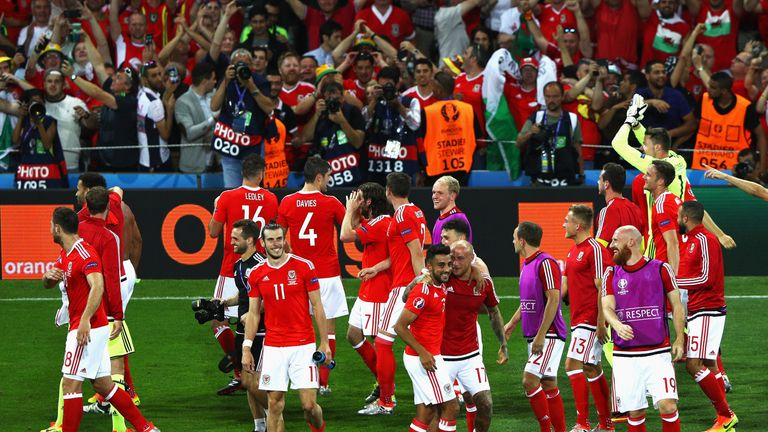 Wales players celebrate their team qualifying as group winners