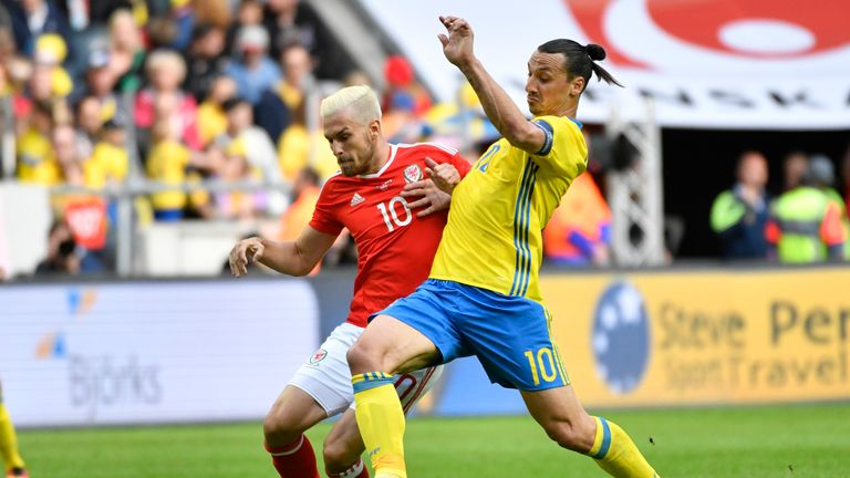 Aaron Ramsey of Wales and Ibrahimovic battle for the ball