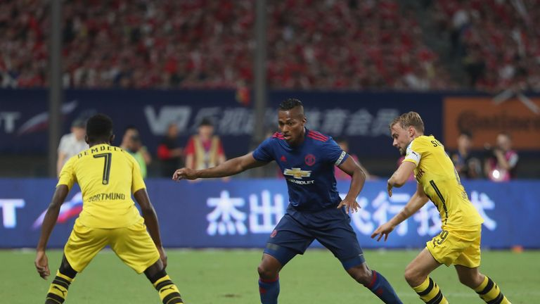Man Utd captain Antonio Valencia (C) battles with Ousmane Dembele (L) and Marcel Schmelzer (R)