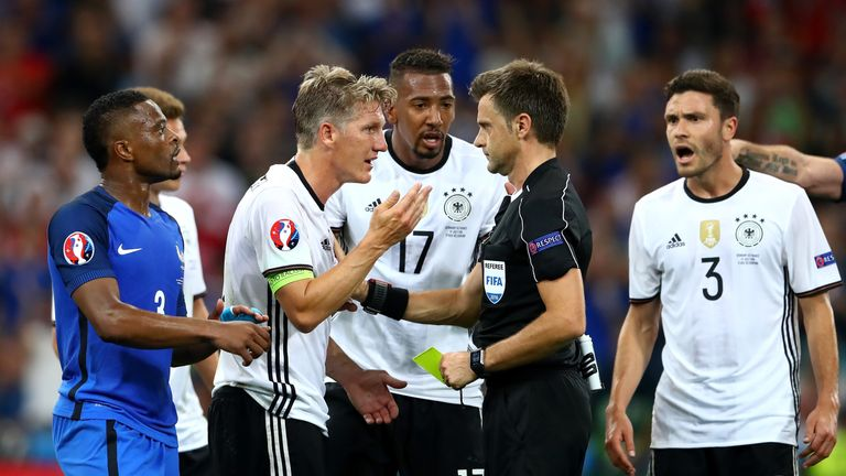 Bastian Schweinsteiger remonstrates with referee Nicola Rizzoli after his decision to award France a penalty