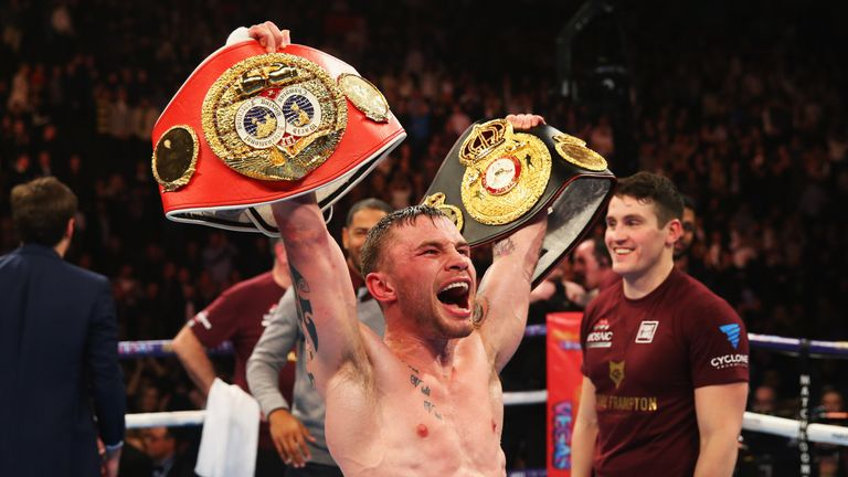 Carl Frampton celebrates a points victory over Scott Quigg after their world Super-bantamweight title contest