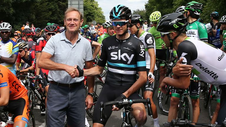 Chris Froome posed for photos with fans when the race was halted after 53km