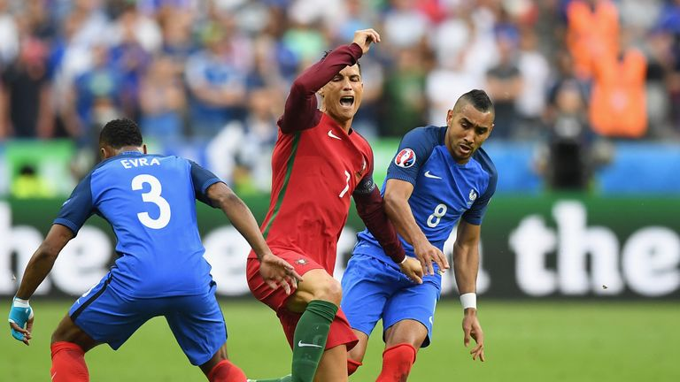 Cristiano Ronaldo (C) of Portugal was hurt after a challenge by France's Dimitri Payet (R) during the Euro 2016 final