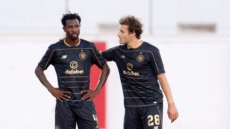 Celtic's Efe Ambrose (left) stands dejected with Erik Sviatchenko