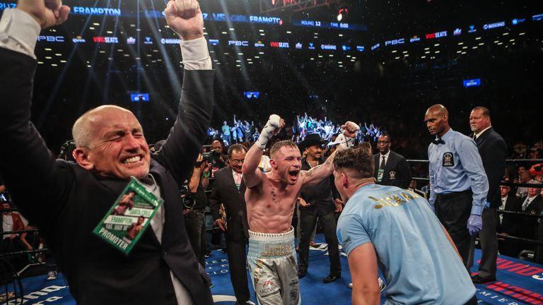 Carl Frampton celebrates winning the WBA featherweight title
