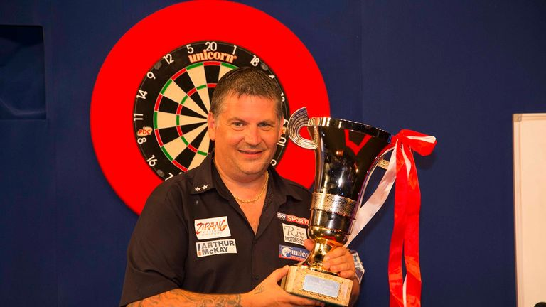 Gary Anderson celebrates with Tokyo Darts Masters title