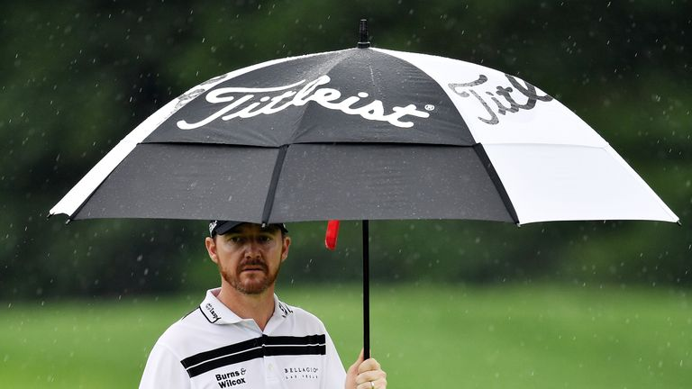 Jimmy Walker defied the rain to reclaim the lead after 54 holes