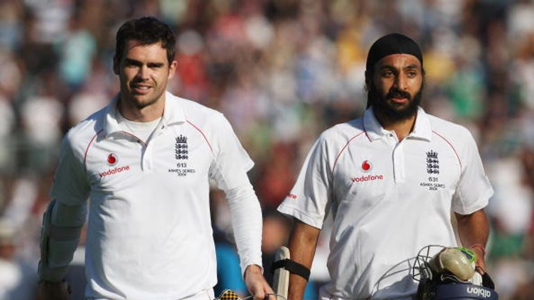James Anderson and Monty Panesar of England walk off after securing the draw during day five of the first Ashes Test against Australia