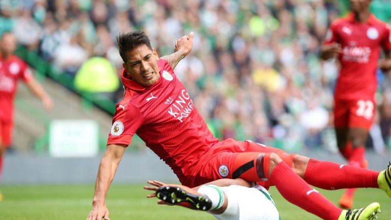 Leonardo Ulloa is brought down at Celtic