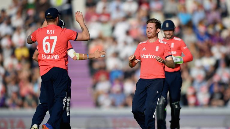 Liam Dawson of England celebrates after one his three wickets on his T20I debut