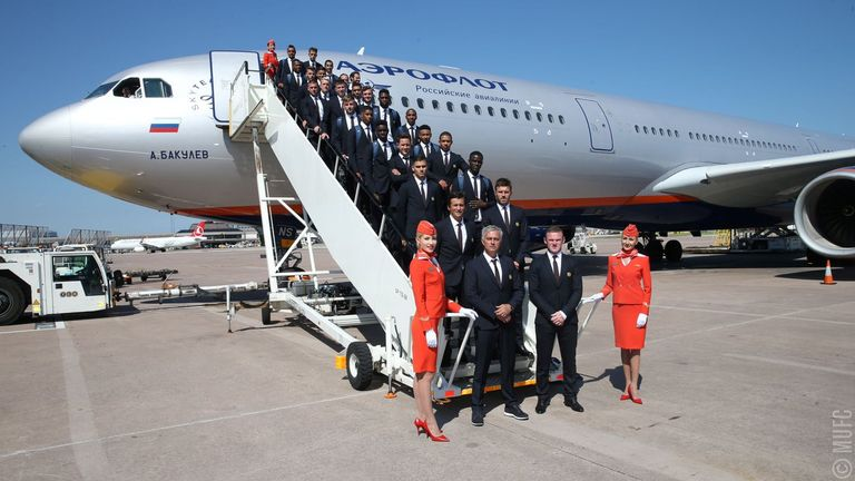 Jose Mourinho and his players posed for a team photo on the aeroplane's steps (Credit: @ManUtd official Twitter)