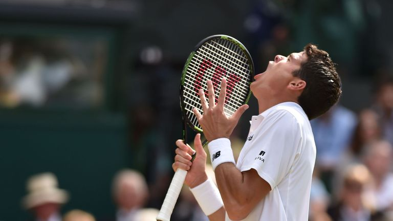 Milos Raonic reacts after a point during his defeat to Murray
