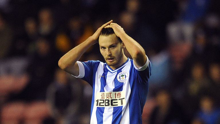 Nick Powell has rejoined Wigan Athletic following his release by Manchester United
