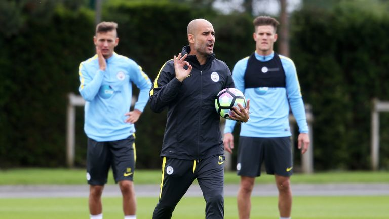 Pep Guardiola (middle) has taken his first training session at Manchester City