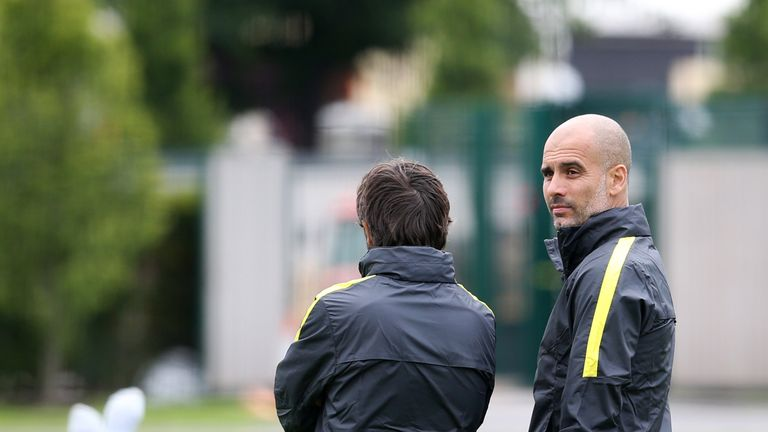 Guardiola looks on during the session at City Football Academy