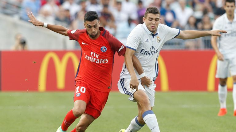 Paris Saint-Germain Javier Pastore (L) and Real Madrid midfielder Mateo Kovacic (R) chase a loose ball